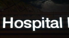 Health Care Hospital Sign At Night Stock Footage