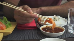 Pouring Salmon Sashimi in Soy Sauce Stock Footage