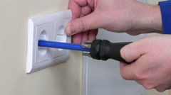 Electrician hands install electrical wall sockets - stock footage
