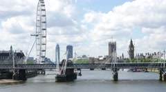 London Eye , Big Ben and Westminster Abbey in London, UK Stock Footage