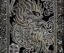 Ancient Chinese dragon art with mother of pearl inlay - stock photo