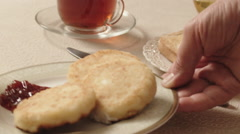 Female hand serves plate with cheesecakes and jam, breakfast with juice Stock Footage