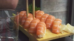 Ten Salmon Nigiri, Chopstick Takes Two Pieces Stock Footage