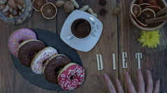 4k Donuts Composition on a Wooden Background with word Diet Stock Footage