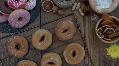 4k Donuts Composition on a Wooden Background with Sugar Powder falling Stock Footage