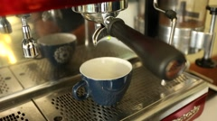 Coffee machine pouring espresso in a cup Stock Footage