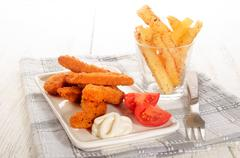 Breaded chicken nuggets with mayonnaise and tomato Stock Photos