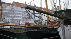 Pigeons sitting on wooden pole of sailing ship in Nyhavn, Copenhagen Stock Footage