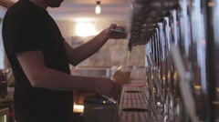 Bartender Pouring Craft Beer From Tap Stock Footage