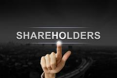 business hand shareholders mission button on black blurred background - stock photo