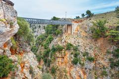 Famous truss bridge over Aradena Gorge, Crete Island, Greece Stock Photos