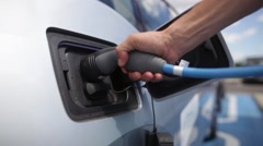 Electric car charging Stock Footage