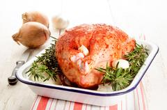 Raw chicken with a marinade made of paprika powder Stock Photos