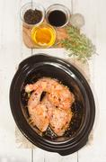 marinated chicken legs in a crock pot - stock photo