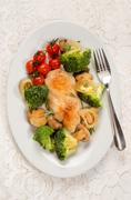 Chicken breast filet on an oval dish with vegetable Stock Photos