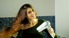 Woman with amazing silky hair drying slow motion Stock Footage