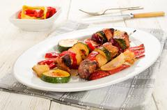 Grilled hungarian meat vegetables skewers on an oval plate Stock Photos