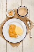 british apple crumble with custard on enamel plate - stock photo