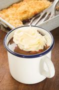 Hot chocolate with whipped cream in a enamel mug Stock Photos