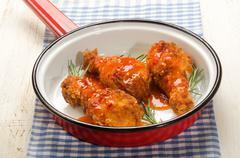 spicy chicken drumstick with rosemary and hot chilly sauce - stock photo