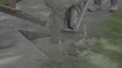 Sidewalk Repair: pouring concrete into corner cutout. (S-log3) Stock Footage