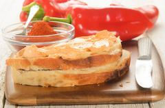 Paprika spread on a slice of bread Stock Photos