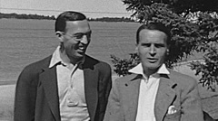 USA 1943: friends talking in front of a lake Stock Footage