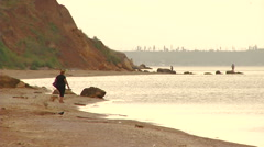 Morning walk on the sand embankment. Real time. Stock Footage