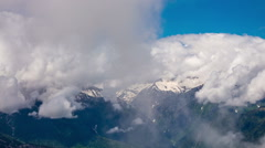 Clouds over the Caucasus mountains on a sunny day, timelapse Stock Footage