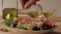 Woman hand pured vegetables with olive oil close-up Stock Footage