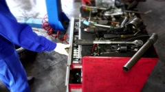 Garage worker showing various tools in drawer box Stock Footage