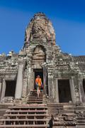 Contemplating monk, Angkor Wat, Siam Reap, Cambodia - stock photo