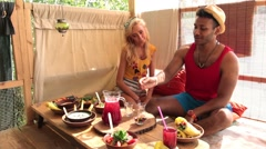 Couple having a lunch on tree house at the beach Stock Footage