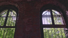 Indoor view to the outdoor forest via old ruined window Stock Footage