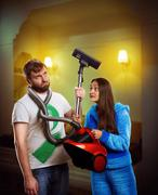 Couple cleaning the house Stock Photos