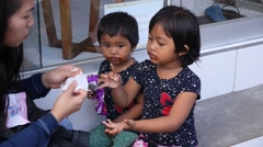 Two Cute Asian Girls Eating Ice Cream. Funny Kids Stock Footage