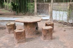 Stone benches in park. Stock Photos