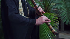 Japanese musician plays on flute Stock Footage