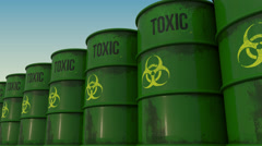 Line of green barrels with biohazard content. 4K seamless loopable animation Stock Footage