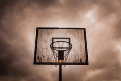 Old disused outdoor basketball hoop - stock photo