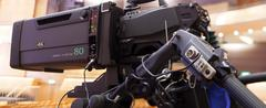 Professional digital video camera. tv camera in a concert hal. - stock photo