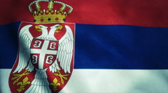 Realistic Ultra-HD flag of the Serbia waving in the wind. Seamless loop with - stock footage
