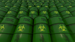 Lines of green barrels with toxic content. Low angle view. 4K seamless loopable Stock Footage