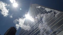 Clouds reflected on modern glassy corporate building  Stock Footage