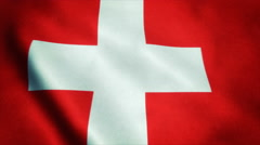 Realistic Ultra-HD flag of the Switzerland waving in the wind. Seamless loop Stock Footage