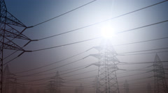 Power line against clear sky, dolly shot. 4K seamless loop able clip - stock footage