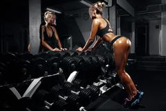 Beautiful sexy woman with perfect abdominal muscles at the gym Stock Photos