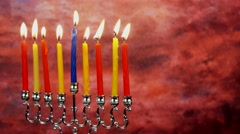 Jewish holiday Hanukkah with menorah traditional Candelabra and wooden dreidels Stock Footage