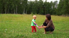 Cute young mother with a small son run the soap bubbles Stock Footage