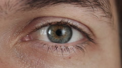 Close-up of a Male's Eye. Pupil of the eye narrows Stock Footage